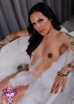 Gorgeous transsexual Foxxy taking a bath