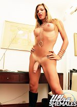 Well hung tranny lets her meaty shepenis hang loose